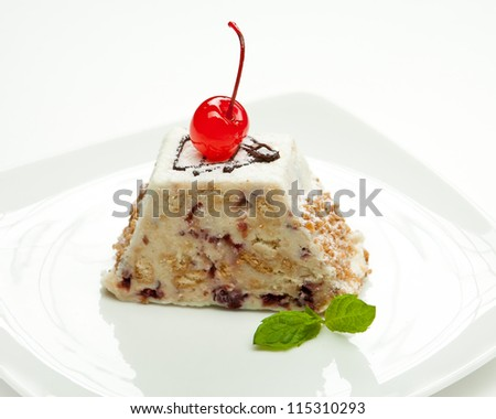Fresh delicious cake with cherry on a white plate - stock photo