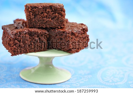 Fresh Delicious Chocolate Brownies on Cupcake Stand - stock photo