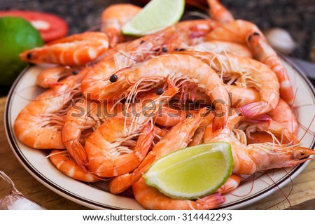 Fresh delicious prawns with lime on the plate - stock photo