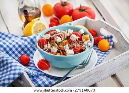 Fresh delicious tomato, onion and feta greek salad - stock photo