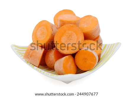 Fresh diced carrots on plate - stock photo