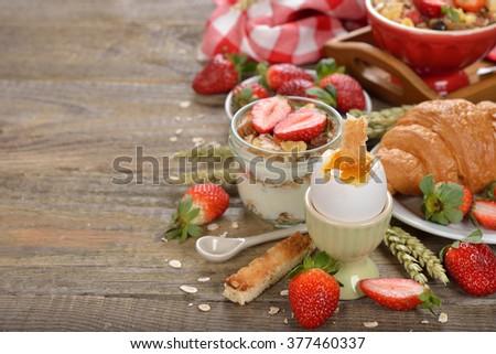 Fresh diet breakfast on a wooden background - stock photo