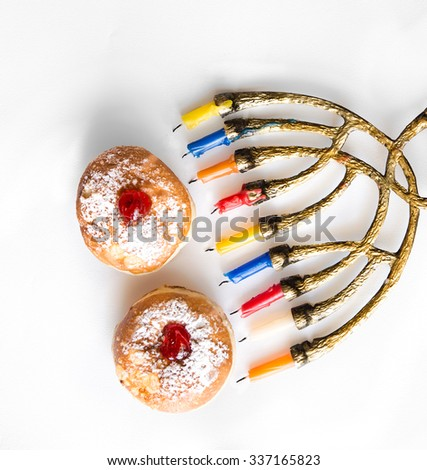 Fresh donuts with jelly  and menorah   for Hanukkah Jewish Holiday. View from above. - stock photo