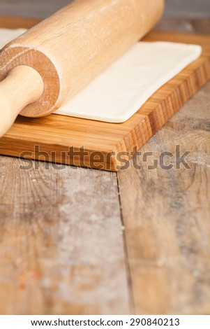 fresh dough ready for baking on rustic wooden background - stock photo