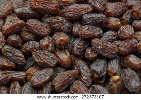 Fresh dried date fruits background in a market place - stock photo