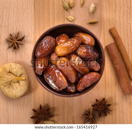 Fresh dry dates in a  bowl top view - stock photo
