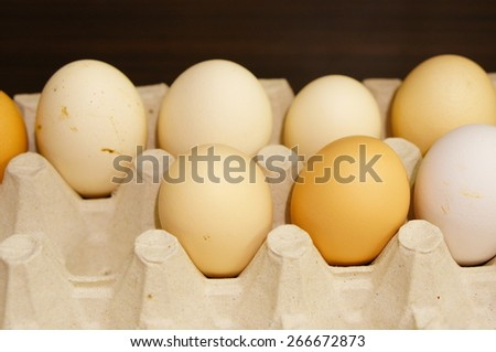 Fresh eggs on a paper box - stock photo