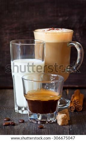 Fresh espresso, glass of froth milk and latte macchiato. - stock photo