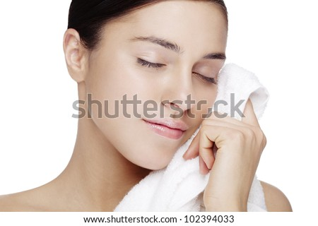 fresh faced female with clean white towel. skin has been retouched to keep all texture - stock photo