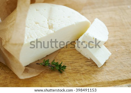 fresh feta cheese. soft focus - stock photo