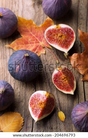 fresh figs and autumn leaves  - stock photo
