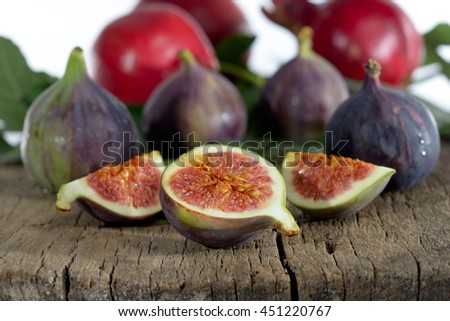 fresh figs and pomegranate - stock photo