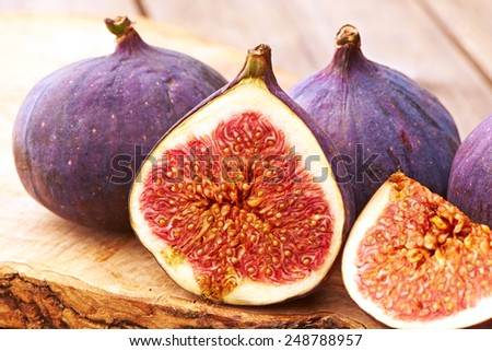 Fresh figs on rustic vintage wooden table - stock photo