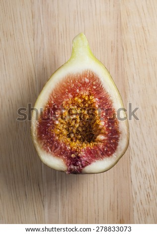 Fresh figs on wooden table - stock photo