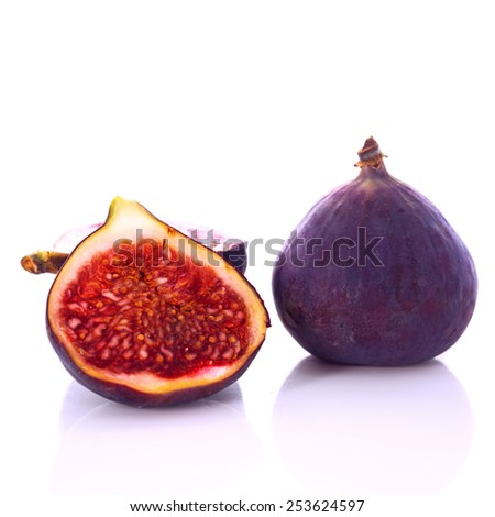 Fresh figs whole and cut isolated on white background - stock photo