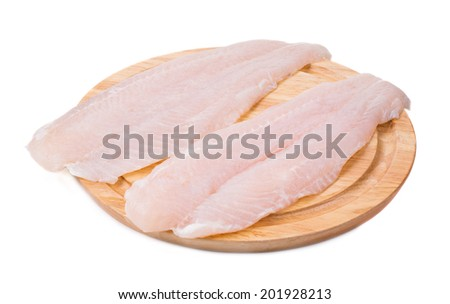 Fresh fillet of pangasius. Isolated on a white background. - stock photo