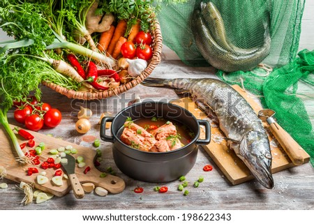 Fresh fish and vegetables for soup ingredients - stock photo