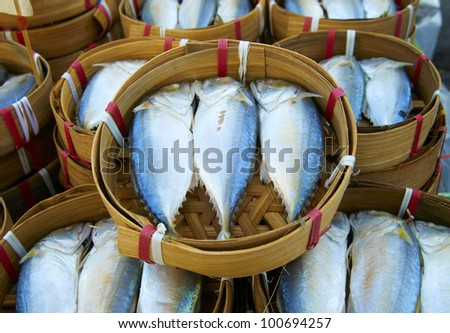 Fresh fish in baskets on Bangkok street market table ready for sale. - stock photo