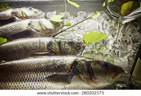 fresh fish in the ice. horizontal photo - stock photo