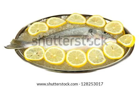 Fresh fish of dorado on tray with  lemon and parsley isolated on white - stock photo