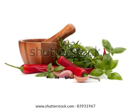 fresh flavoring herbs and spices in wooden mortar isolated on white background - stock photo