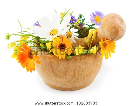 Fresh flowers in wooden mortar isolated on white background - stock photo
