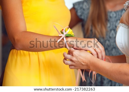 fresh flowers on hand bridesmaids at the wedding - stock photo