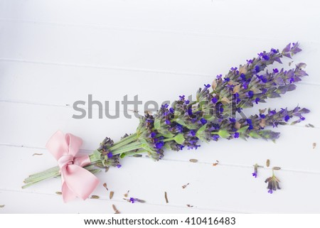 Fresh  flowers posy  close up on white wooden table - stock photo