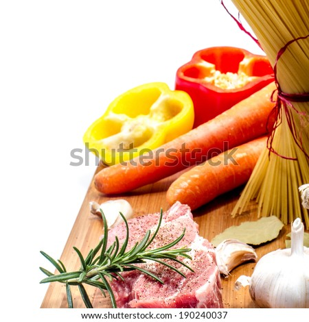 Fresh food ingredients on the chopping board. - stock photo