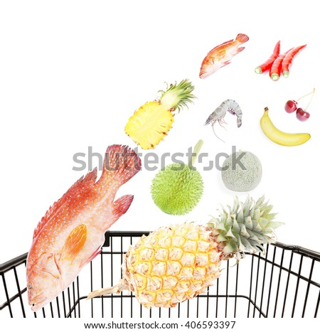 Fresh food products flying into shopping cart isolated on white background - stock photo