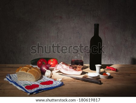 Fresh food with vegetables and wine on the table - stock photo