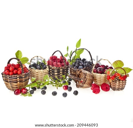 fresh forest mix berries : blueberries , raspberries and strawberries in the basket  isolated on white background - stock photo