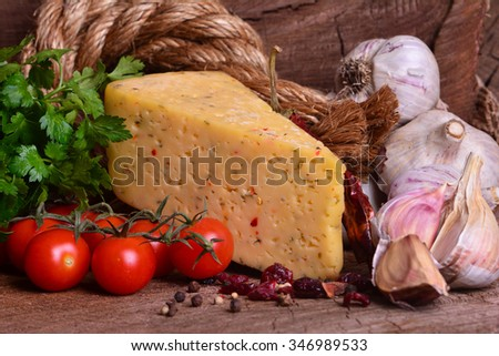 Fresh fragrant cheese with spices - stock photo