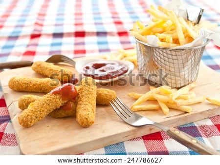 Fresh french fries , Mozzarella Sticks and Ketchup - stock photo