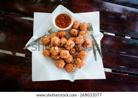 Fresh fried thai no name meatballs served with sweet chilli sauce. Traditional asian cuisine. - stock photo