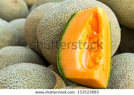 Fresh from the farm display of cantaloupe melons for sale at local farmers market - stock photo