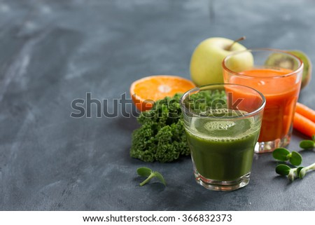 Fresh fruit and vegetable juice in the glass for detox or healthy lifestyle, selective focus - stock photo