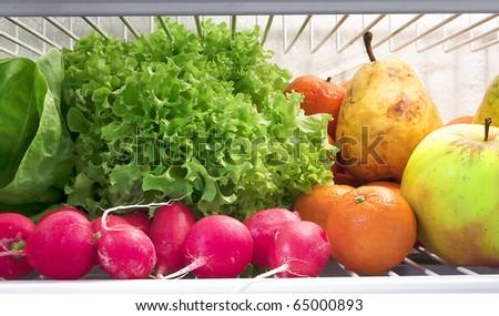 fresh fruit and vegetables in the fridge - stock photo