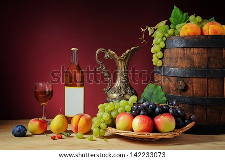 Fresh fruit and wine in the bottle on the table - stock photo