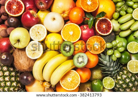 Fresh fruit background. Healthy eating and dieting concept. Winter assortment. Top view - stock photo
