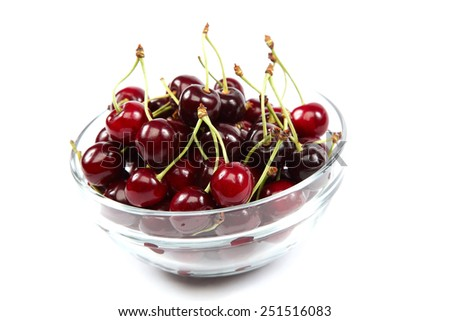 Fresh fruit cherries in a bowl glass isolated on white background. - stock photo