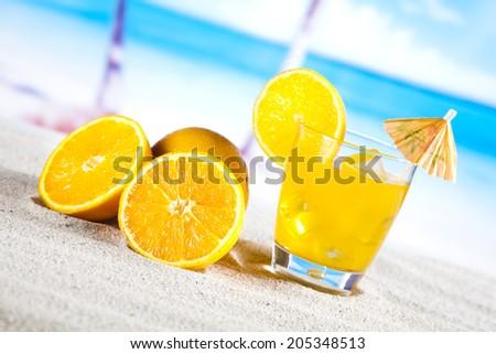Fresh fruit drink on a beach  - stock photo