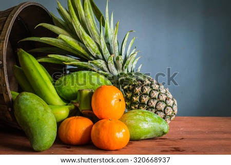 Fresh fruit from the basket put together on a wooden - stock photo