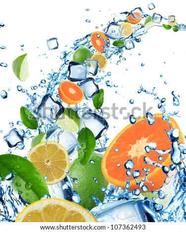 Fresh fruit in water splash with ice cubes - stock photo