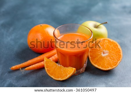 Fresh fruit juice in the glass for detox, selective focus - stock photo