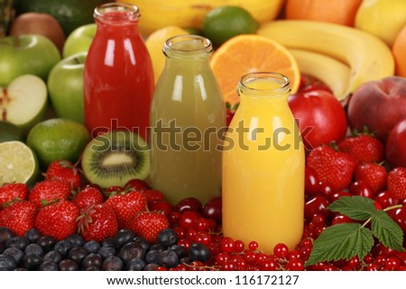 Fresh fruit juices made from red, green and orange fruits - stock photo