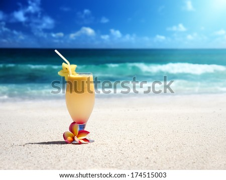 fresh fruit mix of juices on a tropical beach - stock photo