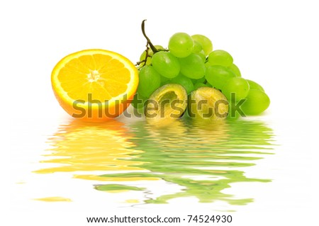 Fresh fruit reflected in water - stock photo