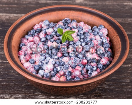 Fresh fruit salad with strawberries and blueberries , wild berry - stock photo