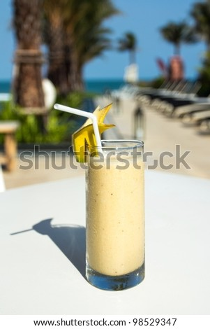Fresh Fruit Smoothy by the Beach - stock photo